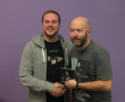 "Julian Austwick receives a Robert Lane CD as second prize for ""Bad Blood"""